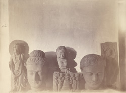 Heads of Buddha and Bodhisattva statues, and sculpture slab representing worship of a stupa, from the Swat Valley